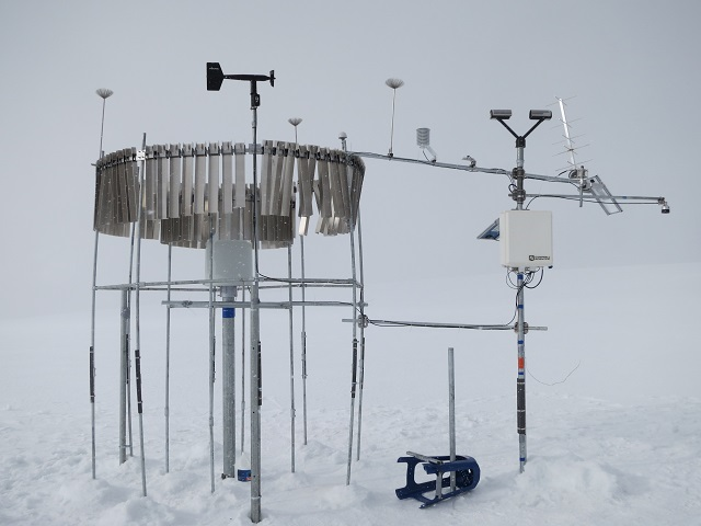 The completed weather station at 18,537 ft in Peru. OTT Pluvio and Parsivel can be spotted in the background.